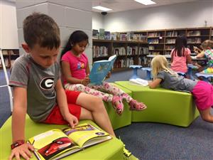 Students love reading on our new soft seating